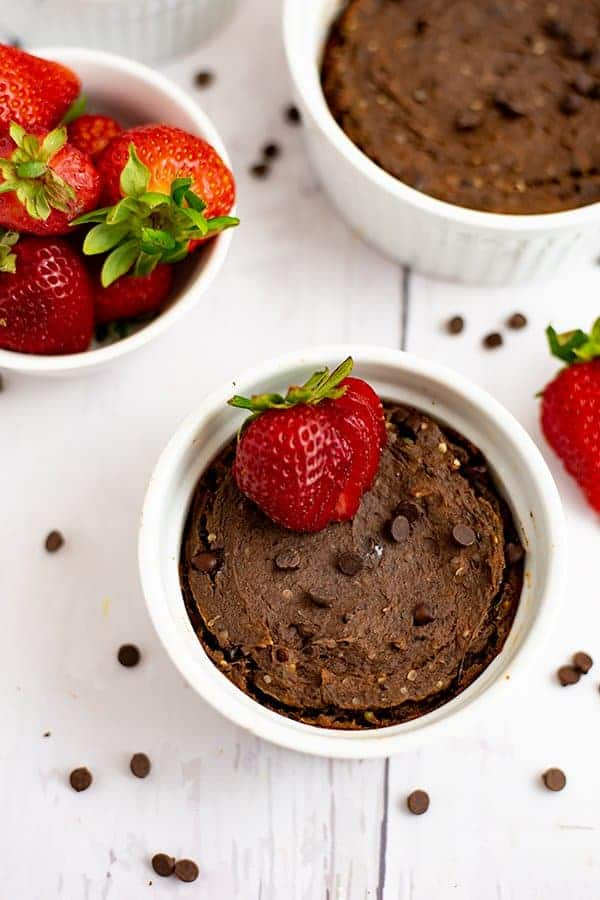 Close up of a single serve brownie in a white ramekin with chocolate chips sprinkled on top