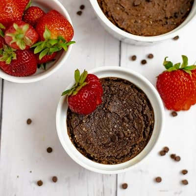 Single serve brownie with a strawberry on top in a white ramekin