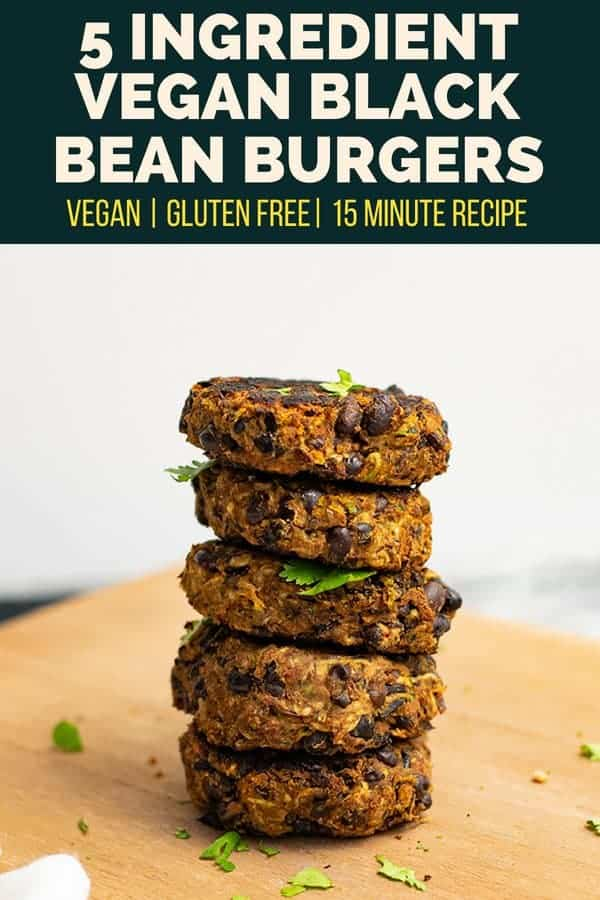 5 Ingredient black bean burger recipe stacked 5 high on a wooden cutting board.