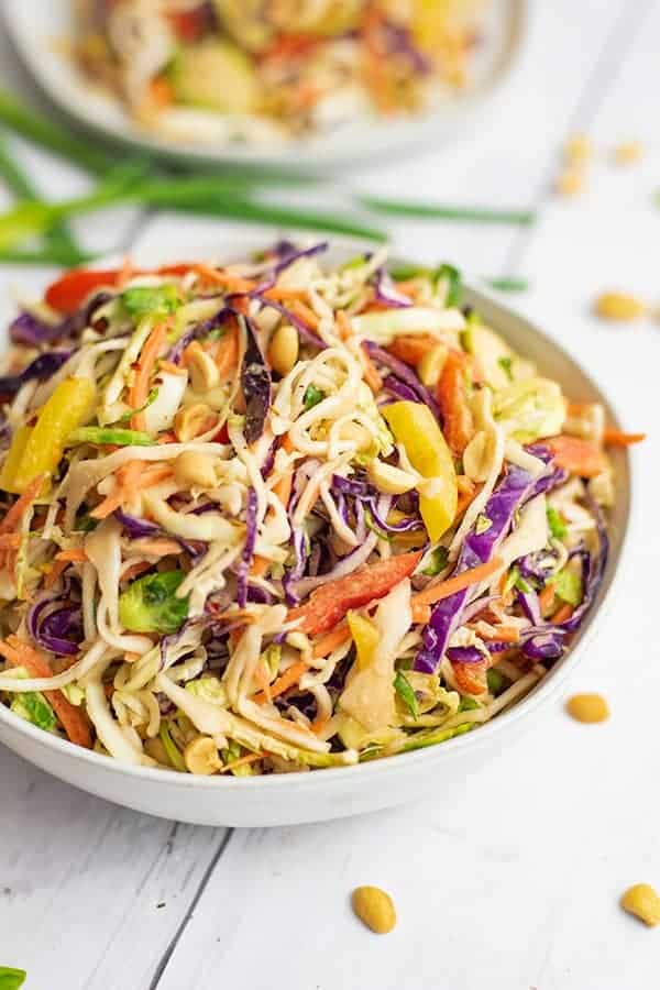 Close up of bowl of Asian Cabbage Slaw with a second bowl in the background