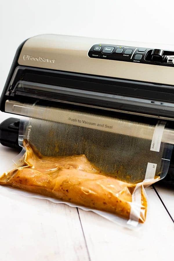 Foodsaver sealing marinaded chicken