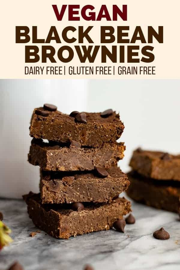 Pinterest pin with description of the pin and a picture of four vegan black bean brownies stacked on top of each other with black bean brownies in the background on a marble slab.