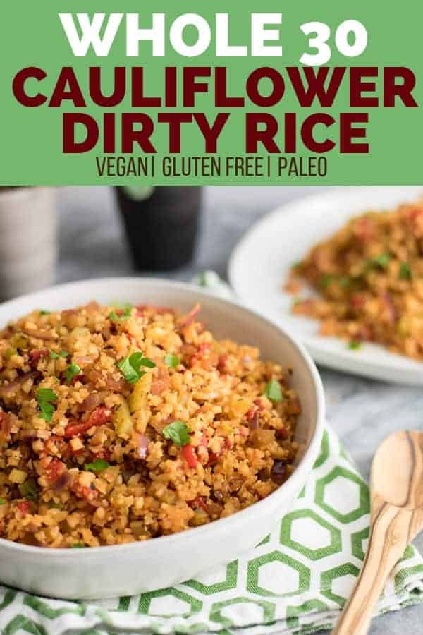 Grain-free whole30 cauliflower dirty rice in a bowl with wooden serving spoon