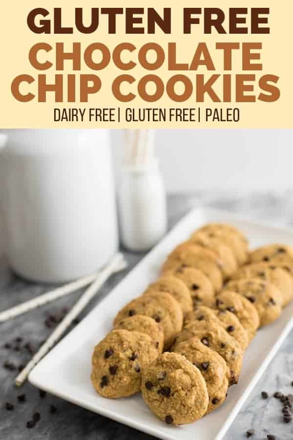 Gluten free dairy free chocolate chip cookies on a serving plate with chocolate chips sprinkled around