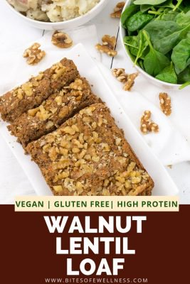 Vegan Walnut lentil loaf with two slices cut from the loaf surrounded by walnuts and a bowl of spinach in the background. Pinterest text on the photo