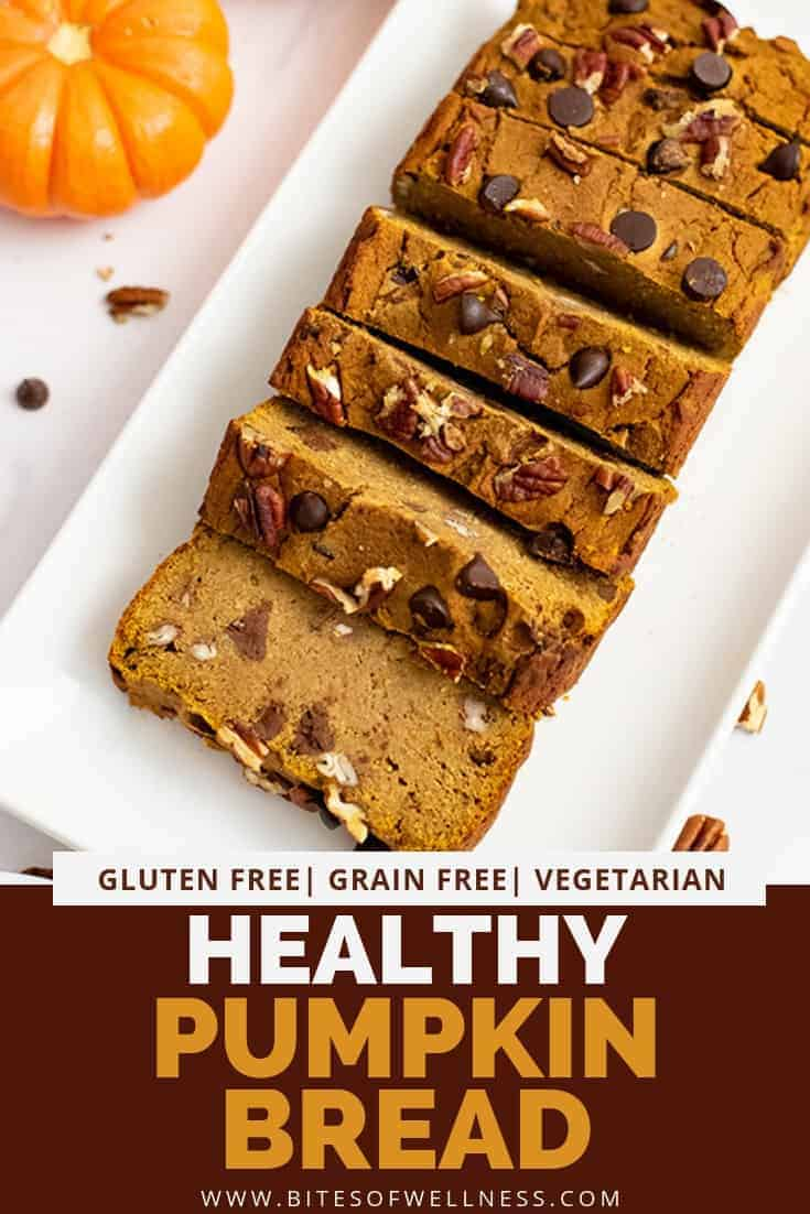 Overhead shot of healthy pumpkin bread recipe cut into slices over a white rectangular plate with pumpkins in the background with pinterest text on the bottom