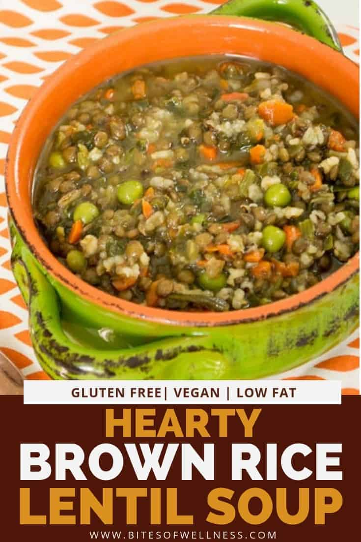 Green bowl filled with hearty brown rice lentil soup over a checkered orange napkin