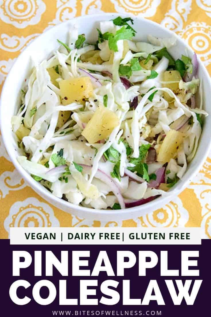 Bowl of pineapple coleslaw over a yellow napkin with pinterest text on the bottom