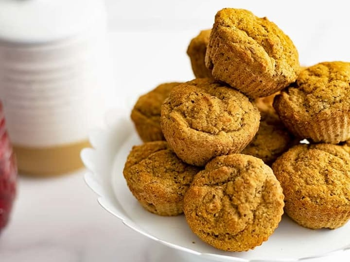 White serving plate filled with gluten free almond flour muffins
