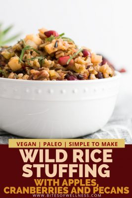 White bowl filled with wild rice stuffing with pinterest text on the bottom