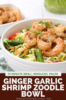 Large white bowl filled with ginger garlic shrimp zoodle bowl with pinterest text on the bottom of photo