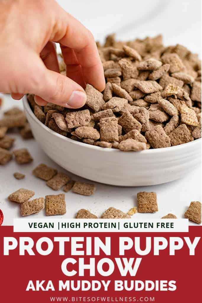Hand reaching into a bowl of protein puppy chow with pinterest text on the bottom