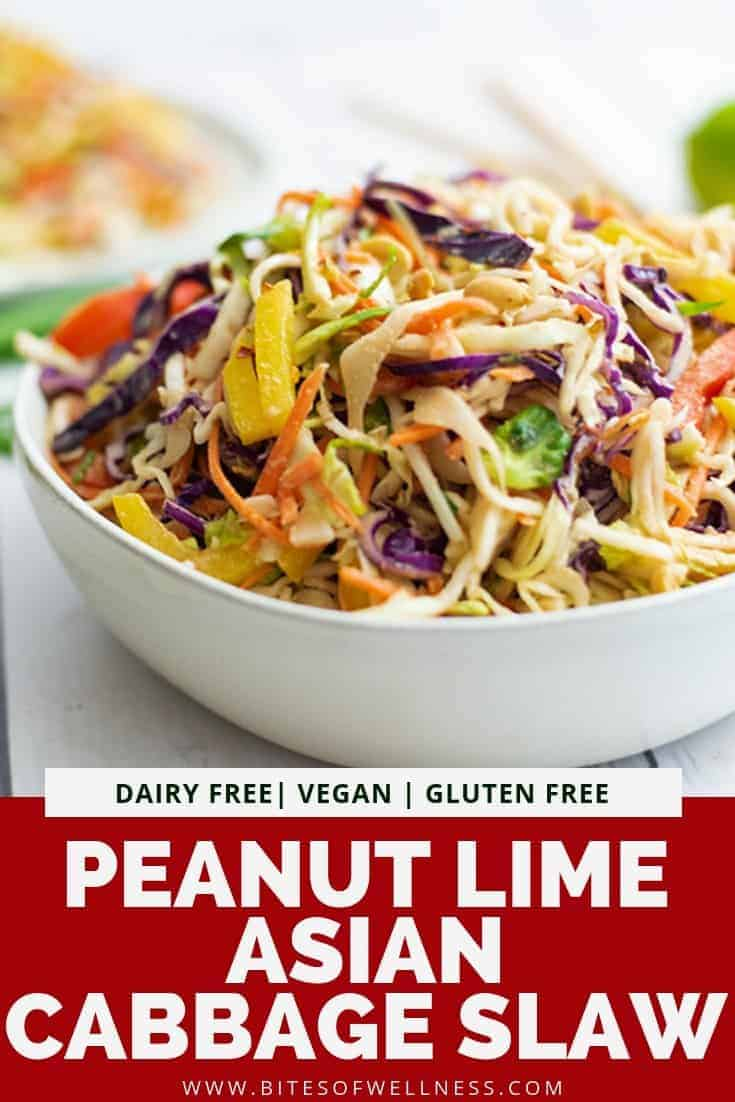 Large white bowl filled with asian cabbage slaw with peanut lime dressing  with pinterest text on the bottom of the photo