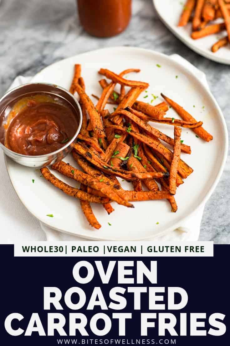 White plate filled with oven roasted carrot fries with a side of ketchup on the plate. Pinterest text on the bottom