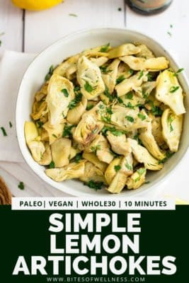 Overhead shot of simple lemon artichokes in a round bowl with pinterest text at the bottom