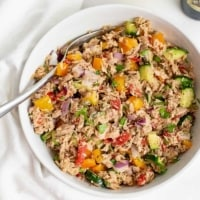 Large bowl filled with healthy Mediterranean tuna salad (no mayo) with a fork resting on the side of the dish