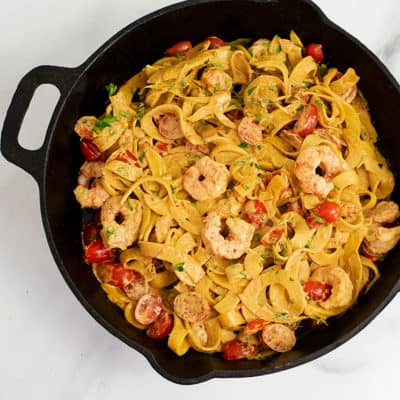 Overhead shot of Cast iron skillet filled with Whole30 Creamy Cajun Shrimp Pasta recipe