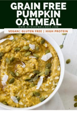 Overhead shot of large white bowl filled with grain free pumpkin cauliflower oatmeal topped with coconut flakes and pumpkin seeds. Pinterest text on the top of the photo