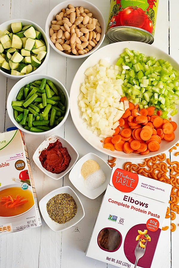 The ingredients for the vegan minestrone soup all on the table, before cooking