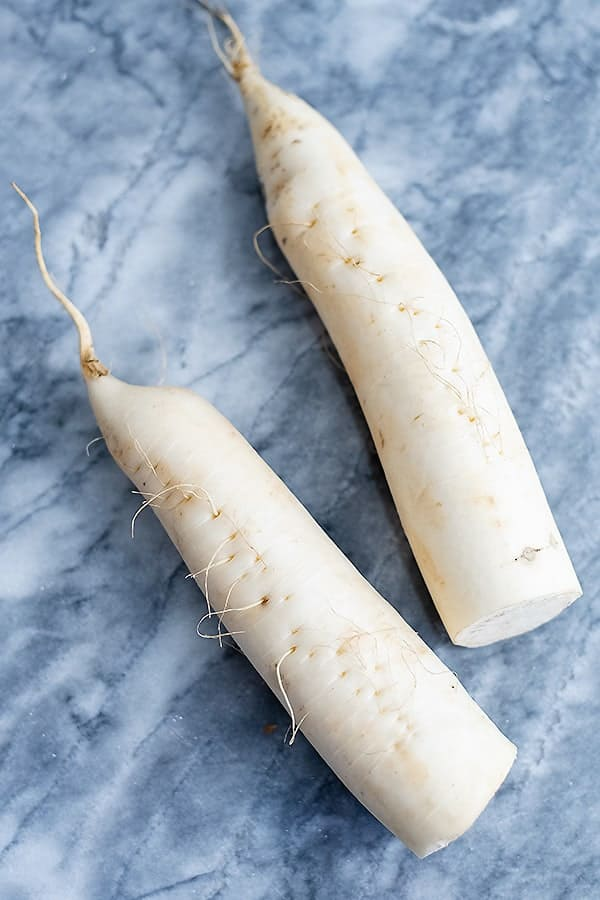 Two daikon radish before making them into low carb pasta