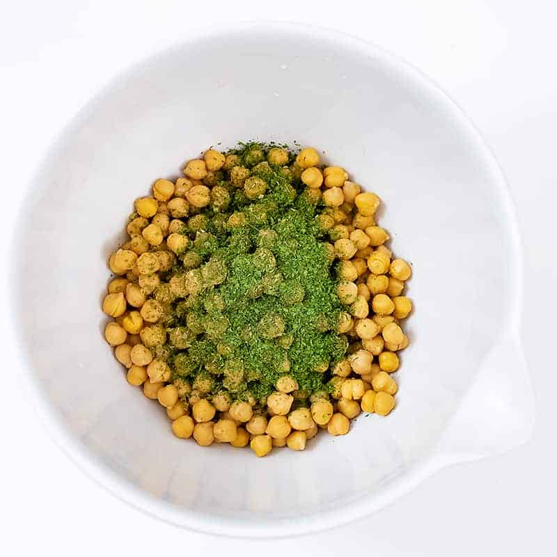 Chickpeas in a large bowl with the ranch seasoning before stirring