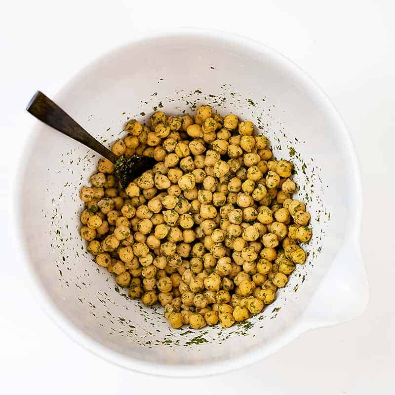 Chickpeas in a large bowl with the ranch seasoning after stirring