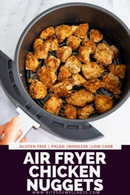 Air fryer basket filled with air fryer chicken nuggets. Pinterest text on the bottom