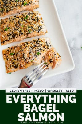 Fork cutting into a everything bagel salmon filet on a serving tray. with pinterest text on the bottom