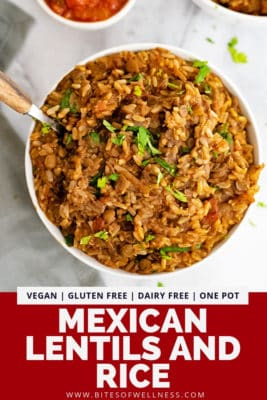 Overhead shot of a large bowl filled with Mexican Rice and Lentils with a wooden handled spoon in the left top side of bowl over a grey napkin. Pinterest text on the bottom