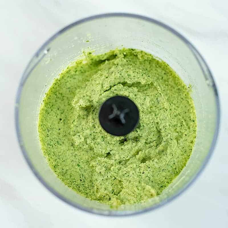 Food processor with artichoke pesto after blending