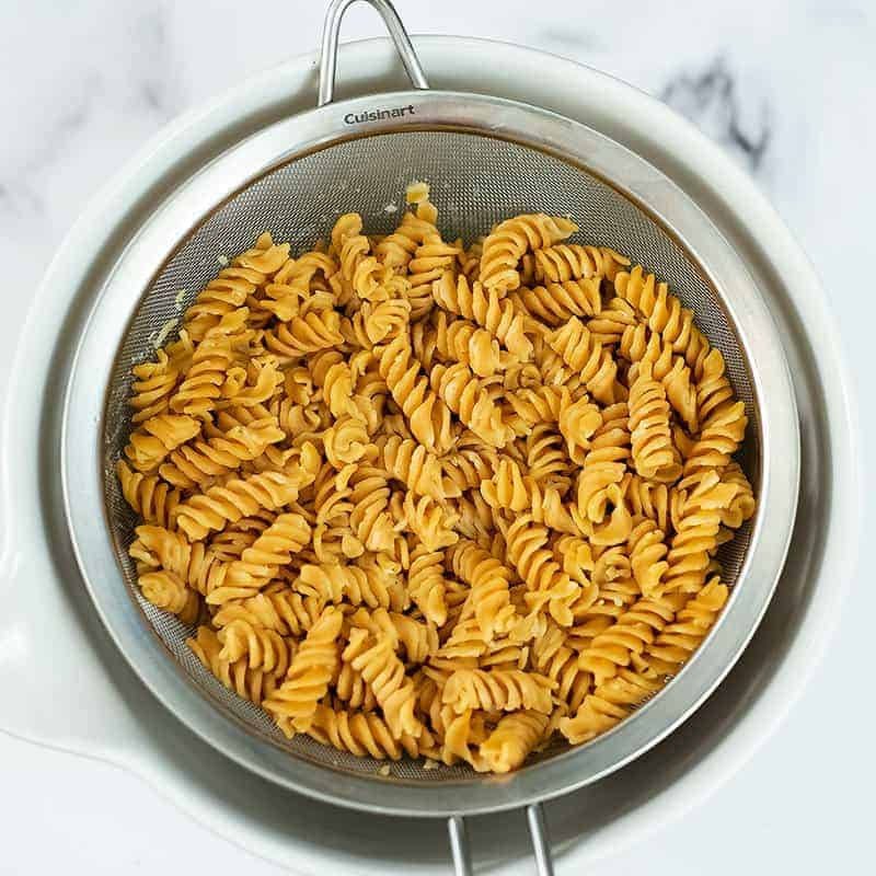 Cooked pasta in a colander.