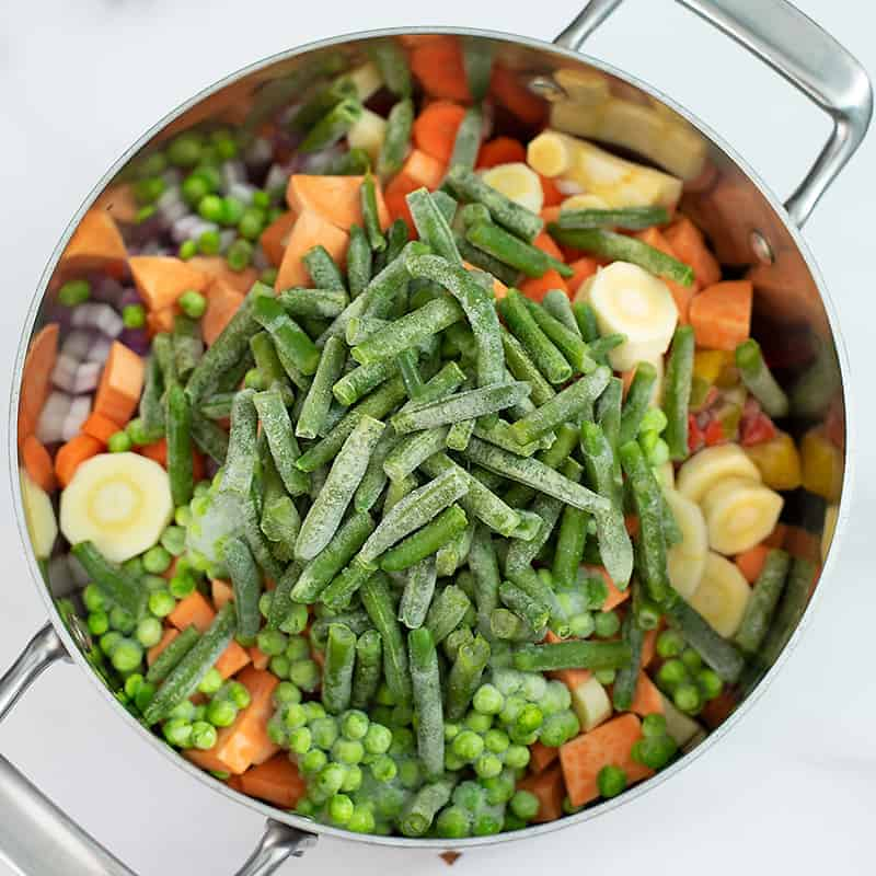 Soup pot filled with frozen veggies