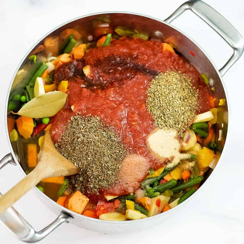 Vegetable soup ingredients in the pot before stirring