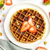 Protein waffle with sliced strawberries and chopped walnuts on top