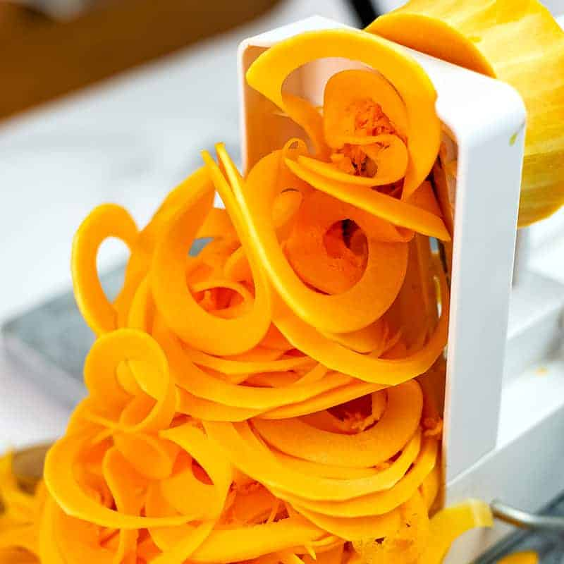 Butternut squash noodles being made on the spiralizer