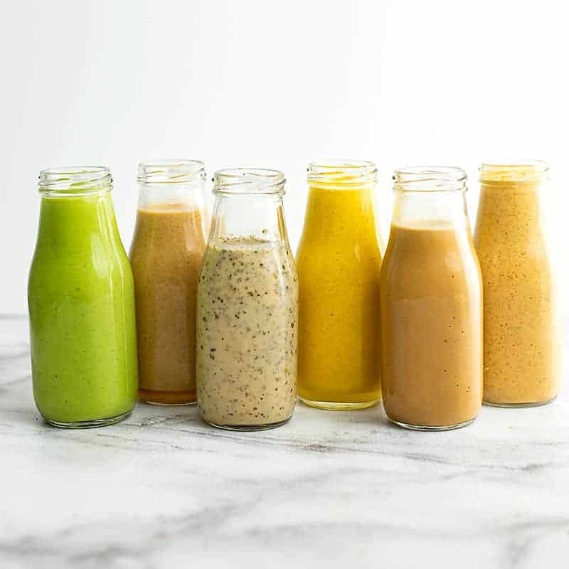 6 Healthy Salad Dressing Recipes in glass bottles