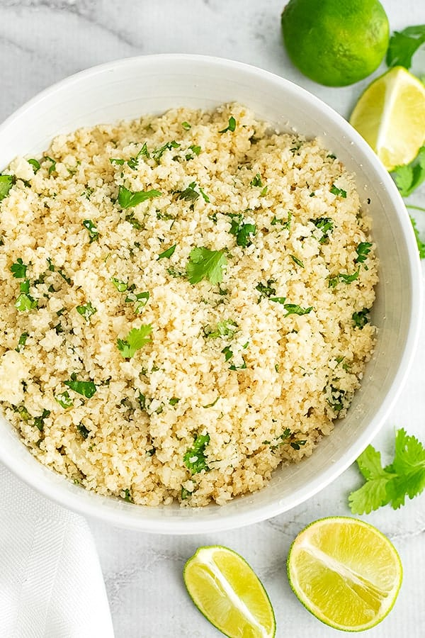 Large white bowl filled with cilantro lime cauliflower rice.