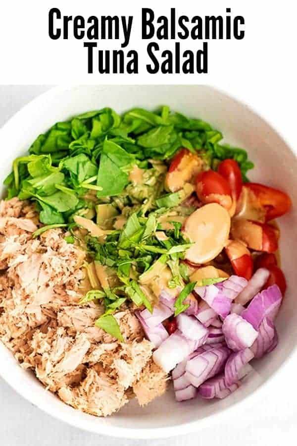 Bowl filled with Creamy Balsamic Tuna Salad ingredients before stirring.