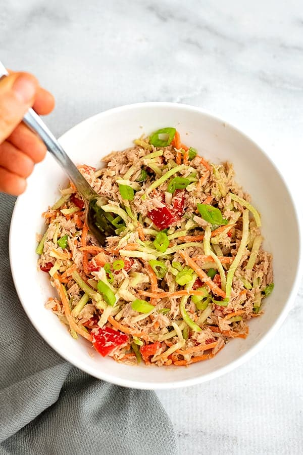 Bowl filled with sesame ginger asian tuna salad ingredients after stirring.