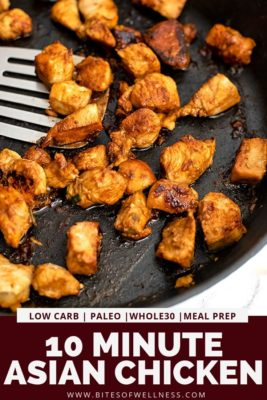 Cast iron skillet filled with asian chicken with silver spatula.
