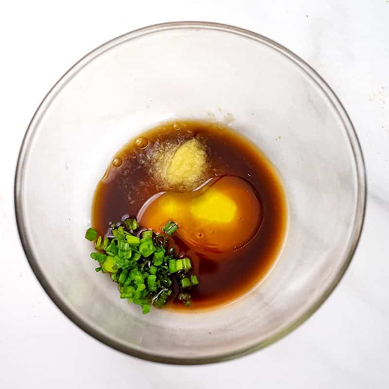 Glass bowl filled with Asian Marinade ingredients.