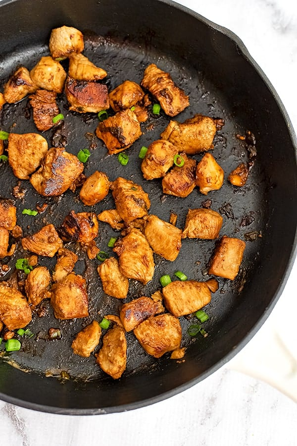 Large cast iron skillet filled with Asian Chicken.