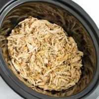 Crockpot filled with shredded ranch chicken.