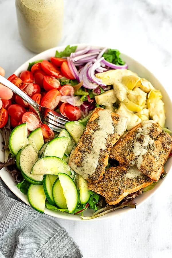 Fork in a bowl of italian salmon salad.