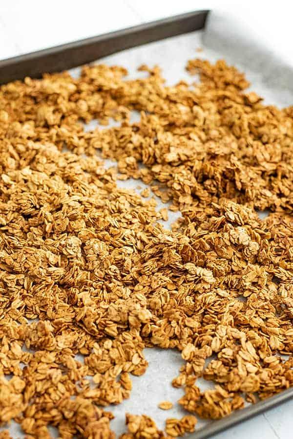 Large baking sheet full of vegan granola.
