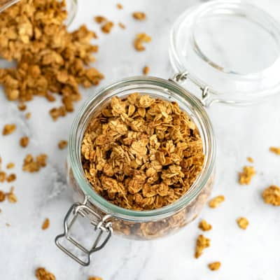 Glass jar filled with vegan granola clusters.