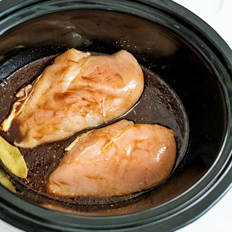 Raw chicken in the balsamic sauce in crock pot.