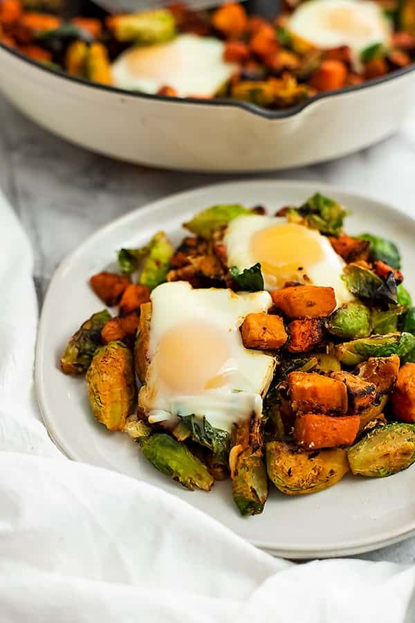 Plate full of sweet potato hash and 2 eggs.