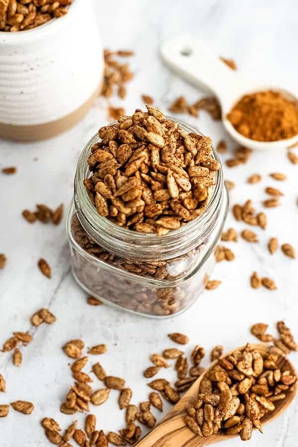 Glass jar filled with pumpkin spice sunflower seeds.
