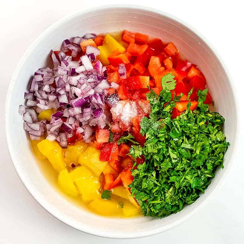 Mango salsa ingredients before stirring.